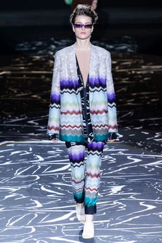 Zigzagging is what the black and white runway did and what the patterns in the colorful, over-the-top outfits did. Missoni showed wildly patterned knits in suits with roomy shoulders à la the late '80s and slinky dresses with keyhole details.    - HarpersBAZAAR.com
