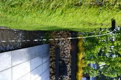 Water feature flowing from the Gabion grass wall in a rill.
