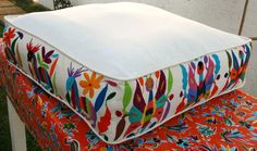 I like the use of pattern on the gusset    Butterfly and Deer Otomi Pouf   Ready to ship by WinkingOwl, $167.00