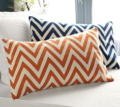 I love the orange chevron pillow cover. And it's machine washable. Chevron Embroidered Lumbar Pillow Cover