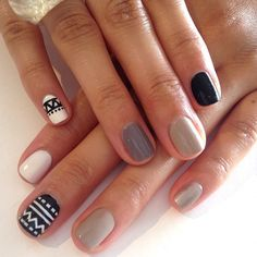 Mix up colours and patterns with your manicure. It's a great way to add some interest to your look during winter.