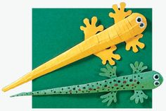 Paper Newt Cut a 2 1/2-inch-by-7-inch strip of paper. Fold it in half lengthwise. Cut the folded strip diagonally. Unfold the strip. The paper should form a tall triangle...