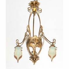 Continental Art Nouveau Brass and Glass Chandelier Early 20th century The openwork floriform standard issuing scrolling branches ending in lemon colored glass globe shades. Height 34 1/2 inches, diameter 23 1/2 inches.