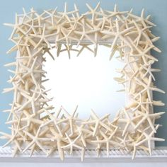 Artisan handmade REAL starfish mirror made with dozens of white finger starfish. It's perfect for any coastal decor or nautical decor, and makes a great gift! Also available in custom sizes. Starfish Mirror, Beach Mirror, Nautical Mirror, Wall Mirror, Coastal Mirrors, Coastal Decor, Decorative Mirrors, Black Brick Wall, Beach House Decor