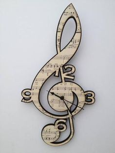 Treble Clef Vintage Music Clock by Neltempo: Genuine vintage music mounted onto birch plywood & cut using laser technology