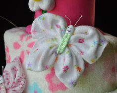Washcloth Butterfly Diaper Cake Topper How To Video. $3.99, via Etsy.