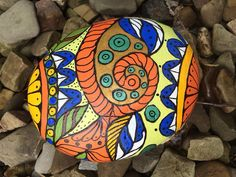 Beautiful hand painted rock created by my mother.