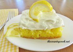 The Country Cook: Lemon Drop Cake - she warns it is for serious lemon lovers - it is lemons on steroids! Lemon cake, lemon glaze and topped with lemon frosting! Lemon Desserts, Lemon Recipes, Just Desserts, Delicious Desserts, Yummy Recipes, Fancy Desserts, Yummy Food, Velvet Cake, Poke Cakes