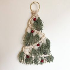 Miniature Christmas trees created with macrame knots are beautiful, original, and modern Christmas decorations Glass Christmas Decorations, Small Christmas Trees, Christmas Tree Pattern, Miniature Christmas Trees, Christmas Tree Design, Christmas Crafts, Tree Patterns, Macrame Patterns, Handmade Ornaments