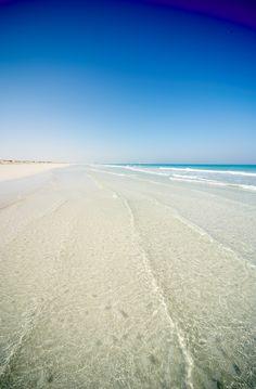 White sand and crystal clear water at The St. Regis Saadiyat Island Resort, Abu Dhabi