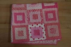 Made my first quilt using this Ragged Square tutorial... was fun to make and turned out cute.