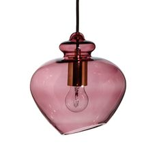 Evoking classic 1960s glassware, the Grace pendant radiates the suave, sophisticated style of the era. The sultry tone of coloured glass sets the mood, not only providing a warm glow but gleaming light from its polished curves.