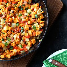 Sweet Potato Hash 1 ½ lbs. sweet potato, diced (about 4 ½ cups) 8 oz. russet potato, diced (about 1 ½ cups) 1 tbsp olive oil 5 oz. Canadian bacon, cut into ½-inch pieces 2 cloves garlic, minced ¼ tsp red chile flakes 1 red bell pepper, cut into ½-inch dice 3 green onions, thinly sliced, divided ½ tsp kosher salt ½ tsp ground nutmeg) 1 tbsp finely chopped fresh sage