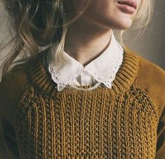 Cute White-Collared Button-Up Worn Under A Mustard-Yellow Knit Sweater