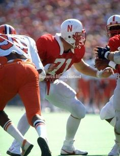 Dean Steinkuhler - OG.. was an integral part of the Huskers' 1983 offensive line that helped Mike Rozier become only the second running back to gain over 2,000 yards in a single season.Named to nearly every All-America list that season.No ordinary lineman, Steinkuhler is often remembered for his touchdown run in the 1984 Orange Bowl. An intentional fumble by then-QB Turner Gill, Steinkuhler scooped it up and rumbled 19 yards for a score.