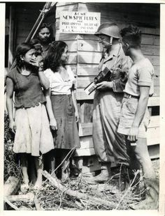 1944- ACME Newspictures photographer Thomas Shafer explains operations of the ACME bureau headquarters he established on Leyte a few minutes after U.S. invasion of Philippines.