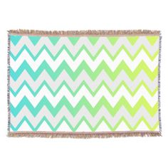 Green and blue gradient chevron stripes with light gray and white.
