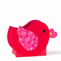 A pretty red felt bird with a patterned pink wing is ready to deliver your gift to your Valentine. Red saddle stitch grosgrain ribbon handles add the perfect finishing touch.