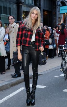 tartan with leather - Cara gives a lesson in a seriously hot take on the biker trend. She's not model of the year for nothing!