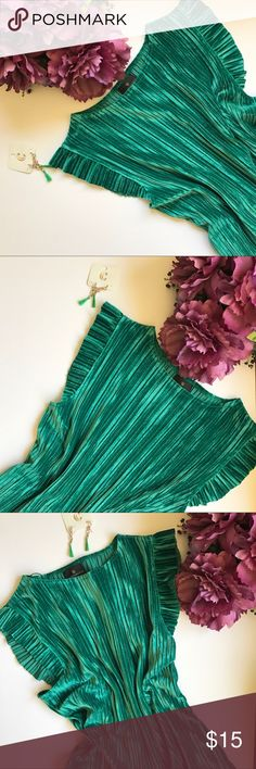 NWT Crushed velvet top with ruffle shoulder New with tags, Crushed velvet, Ruffle crushed velvet shoulder, Green color, Made of 92% polyester & 8% spandex.  Available in several colors and sizes in my closet.  Check the images and feel free to ask questions. Reasonable offers always welcome. Bundle and save Worthington Tops Blouses