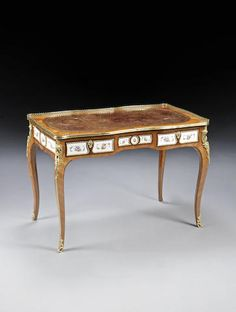 A mid Victorian kingwood, tulipwood and rosewood banded and floral painted white porcelain mounted bureau plat in the Louis XV style, applied with gilt bronze mounts