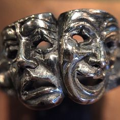 Our Comedy Tragedy Ring: These two masks are symbols of the ancient Greek Muses, Thalia and Melpomene, the Muse of comedy represented by the laughing face, and the Muse of tragedy represented by the weeping face, respectively. Made from British hallmarked .925 sterling silver. #comedytragedy #thegreatfrog