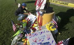 Chattanoogans gather at prayer vigil after recruiting center shootings  A U.S. Navy veteran, who did not wish to be identified, places an item on a makeshift memorial outside a military recruiting center on Friday, July 17, 2015, in Chattanooga, Tenn. Mohammad Youssef Abdulazeez of Hixson, Tenn., attacked two military facilities on Thursday, in a shooting rampage that killed four Marines. (AP Photo/John Bazemore) Photo by Associated Press /Times Free Press.