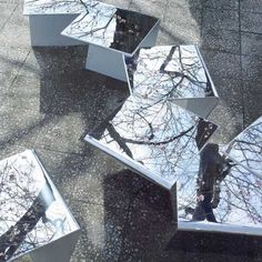 These mirrored benches by Japanese firm Mount Fuji Architects Studio sit beneath cherry trees at the Towada Art Centre in Japan