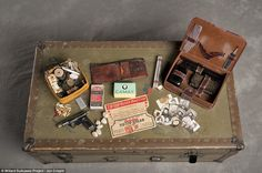 This case belonged to Frank C., a U.S. Army veteran from Brooklyn, New York. Here, a sewing kit, personal grooming kit, toy pistol and bread ration card are all visible. He also carried several photos of himself and his family.