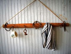 Antique Horse Yoke Upcycled Into A Hanging Rack with Antique Hooks. $87.00, via Etsy.