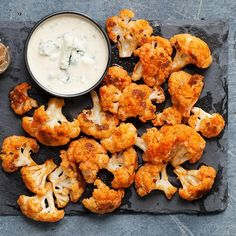 This recipe for spicy Buffalo cauliflower bites is a great vegetarian alternative to Buffalo wings. Roasted cauliflower stands in for chicken and provides more fiber and fewer calories. Serve this easy appetizer with carrot sticks, celery and your favorite ranch or blue cheese dressing.