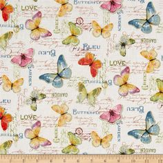 Rainbow Seeds Butterflies White from @fabricdotcom  Designed by Lisa Audit for Wilmington, this cotton print fabric features beautiful butterflies soaring across the fabric with what appears to be garden cards below. Perfect for quilting, apparel and home decor accents. Colors include white, black, tan, cream, mustard, shades of blue and green, purple, lavender, coral and shades of pink.