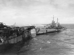On this day ,october 24 1944: USS Reno fighting fires from alongside the port quarter of the burning USS Princeton, which had been hit by Japanese air attack earlier in the day.