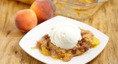 Southern Peach Cobbler -Sweet Peaches covered in butter, brown sugar and spices and topped with a simple moist cobbler batter and cinnamon sugar.