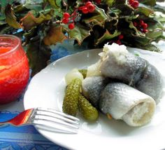 Danish Rollmops from Food.com:   There are so many variations and recipes for Pickled herring, salted herring etc. This recipe has been an old standby for my Mum and I like it. However I usually buy the tinned wine cured whole filets for special occasions they are super. Serve the herrings with fresh chopped onions and perhaps some capers