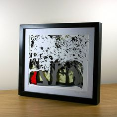 """A beautiful three dimensional papercut depicting a scene from """"Little Red Cap"""". This signed multi-layered papercut has been hand cut and staggered on a . Little Red Cap Layered Papercut Black Paper, Red Riding Hood, Box Frames, Little Red, Shadow Box, Three Dimensional, Paper Cutting, Fairy Tales, Arts And Crafts"""