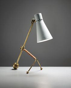 TAPIO WIRKKALA,Adjustable table lamp, model no. K 11-16, circa 1958.Tubular brass, leather-bound tubular brass, brass and painted aluminiu...