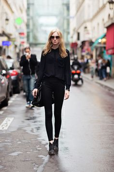 Black, sheer blouse; black bra; black skinny jeans; black, lace-up boots. Carolines Mode | StockholmStreetStyle