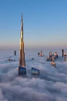 A close-up view of the majestic Burj Khalifa surrounded by a thick blanket of fog. Dubai, UAE By Daniel Cheong.