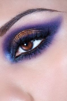 shimmery purple smoky eye.  Love the sparkly bronze on the lid.