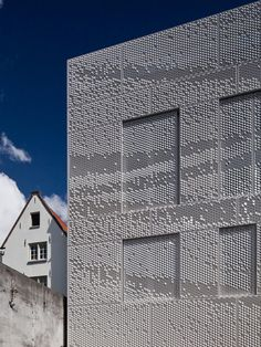 Aluminum sheets are perforated with a pattern that allows the shapes to be bent up or down. When bent up the surface catches the (sun)light and bent down the surface is shaded. In this way intricate graphics can be applied onto the building with punch perforated panels without the use of expensive laser cutting. Bent turns shadow into ink. http://www.archello.com/en/project/bent-0
