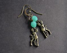 Cute and adorable,these fawn earrings are double sided and each deer has a cool skull tattoo on it's side. These earrings hang with a mint colored czech glass bead. Feel free to ask for another color, and the last two photos show what the yellow bead looks like. Let me know at checkout if you wan...