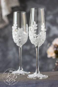 Personalized wedding glasses Wedding champagne glasses toasting flutes light ivory pearls Cnampagne flutes wedding gift Champagne glasses Set For these glasses color - pearl white paint, light ivory pearls and silver color crystals and rhinestones All Wedding Toasting Glasses, Wedding Champagne Flutes, Toasting Flutes, Flute Champagne, Best Champagne, Champagne Glasses, Decorated Wine Glasses, Painted Wine Glasses, Wine Glass Candle Holder