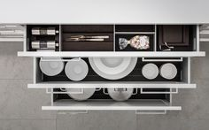 Individual meets functional with unique interior accessories for the kitchen, only from SieMatic: Create a place for everything in your kitchen.