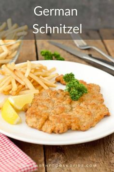 Lightly breaded and fried until golden brown, pork schnitzel is a traditional German meal often served in restaurants and pubs with only a few fries, a wedge of fresh lemon, and parsley. An easy, delicious meal anyone can make at home! #schnitzel #porkschnitzel #schweineschnitzel German Schnitzel, Chicken Schnitzel, Schnitzel Recipes, Simple Green Salad, Brown Sauce, Pork Cutlets, Boneless Pork Chops, Canadian Food, Fried Pork