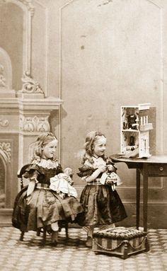 2 adorable Victorian girls playing with their dolls. Again, a studio photograph with a painted backdrop. No idea of  date for this image but probably post-1850