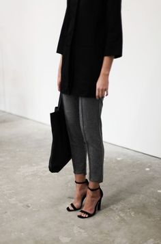Grey trousers, black top