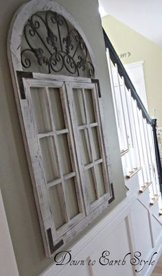 Love this! Using old window frames, doors or shutters as wall decor!
