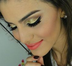 metallic gold eye with a coral lip