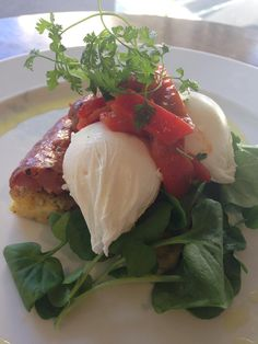 New to the day menu! Parmesan polenta cake with poached eggs, chorizo and harissa sweet red peppers, a flavour sensation and gluten free too. Olive Restaurant, Wellington. http://www.oliverestaurant.co.nz/